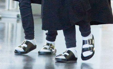 Two people wearing Birkenstock sandals
