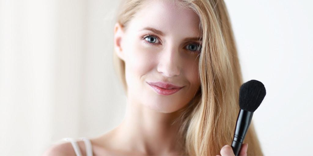 Woman holding makeup brush