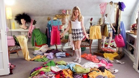woman surrounded by colorful clothes