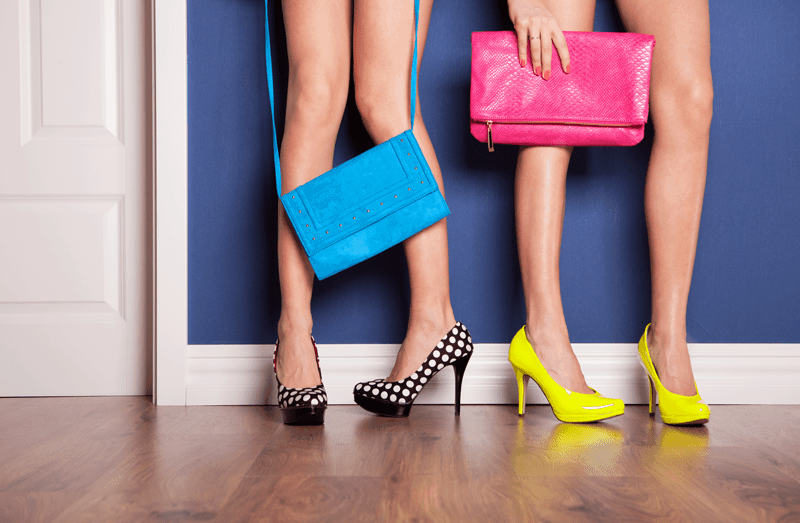 women's legs with bright purses and shoes