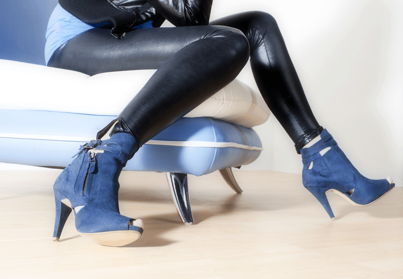 woman's legs dress in black leather pants blue suede boots