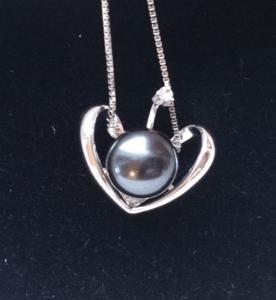 black pearl pendant on black velvet