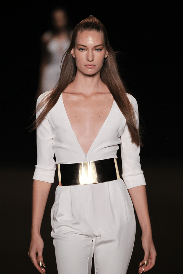 runway model wearing white romper