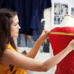 woman in yellow top measuring red dress