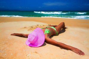 tan woman laying on beach