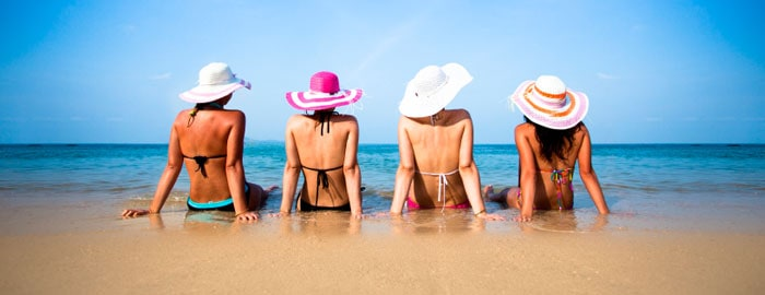 Women wearing bathing suits on the beach