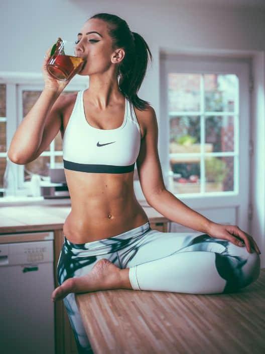Thin, fit woman drinking tea