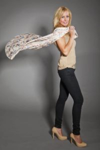 portrait of beautiful a woman with flying silk scarf