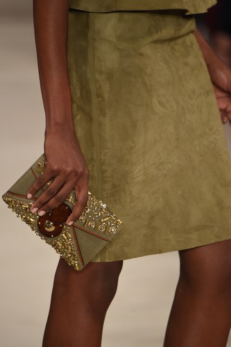 green suede skirt and matching hand bag