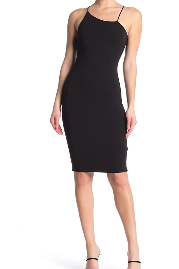 Woman wearing black asymmetric bodycon dress