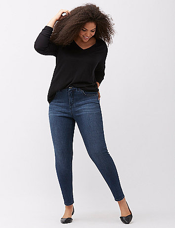 Woman wearing jeans and black sweater