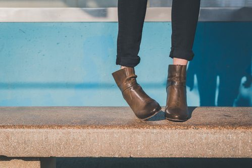 Don't tuck loose jeans into your ankle boots - roll them up instead.