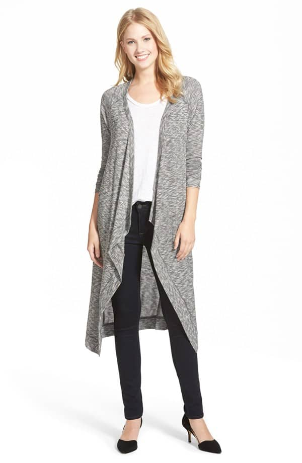 Young woman wearing gray duster cardigan