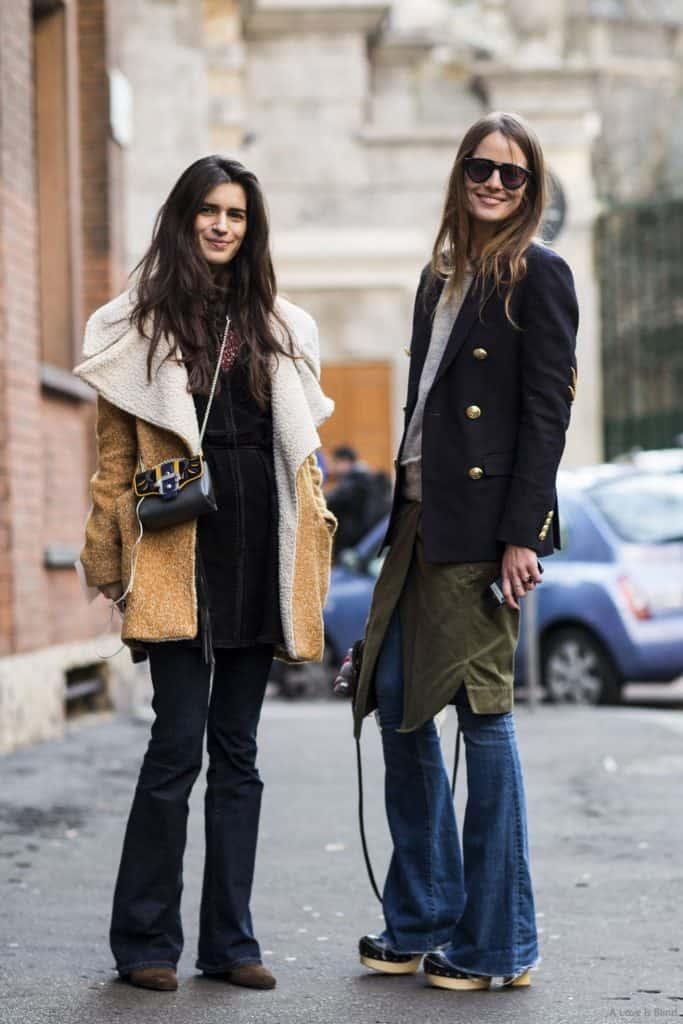Two women wearing flared jeans