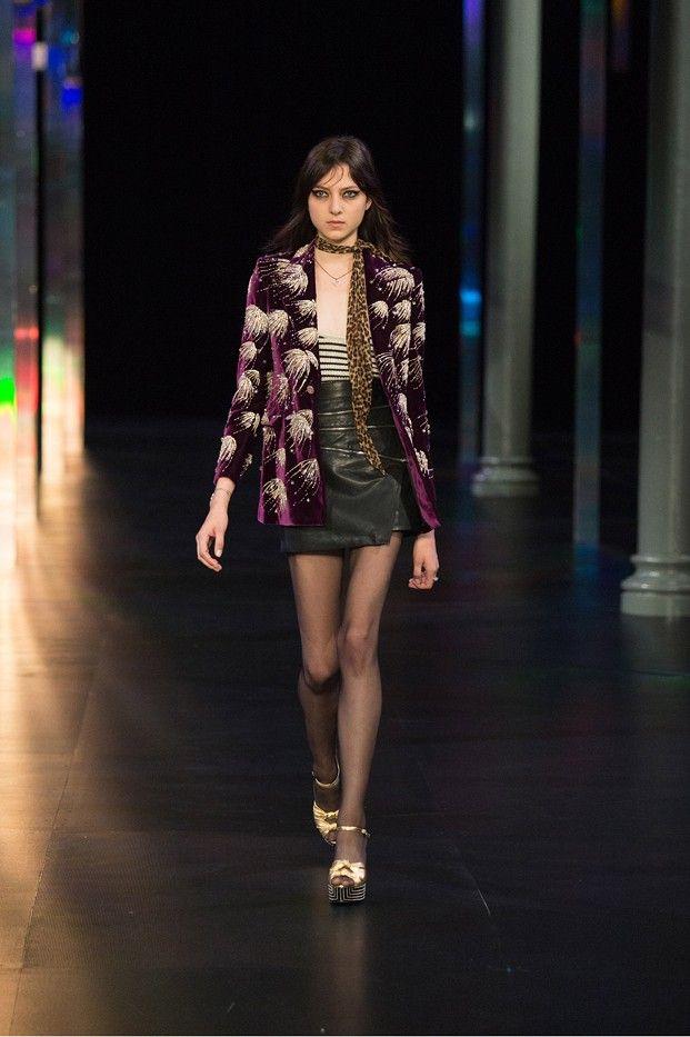 Runway model wearing leopard print skinny scarf