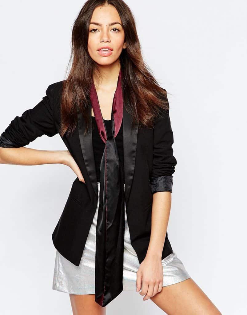 Model wearing blazer and skinny scarf
