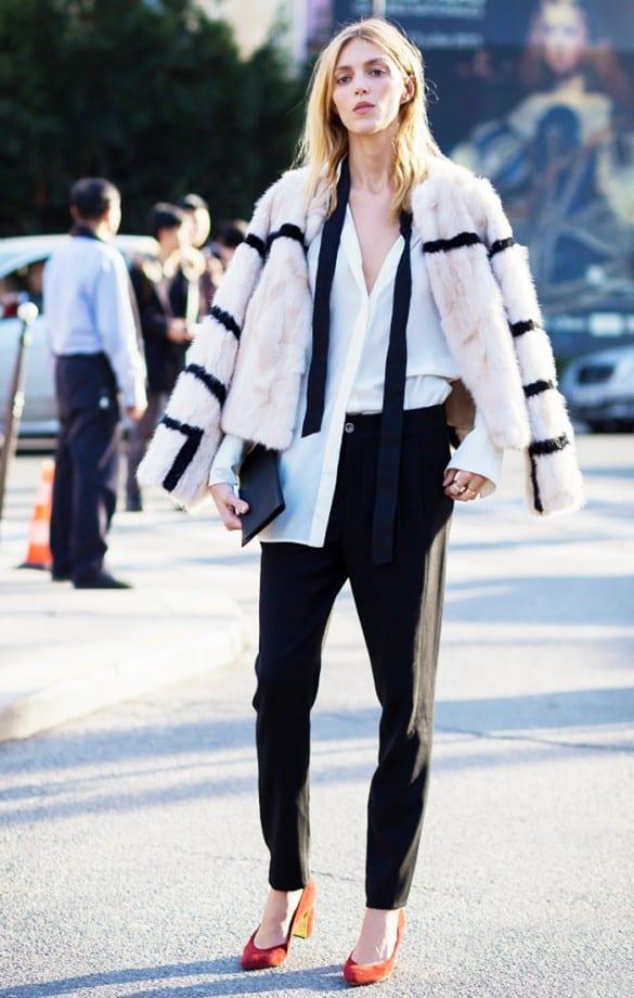 Woman wearing skinny scarf and fur coat