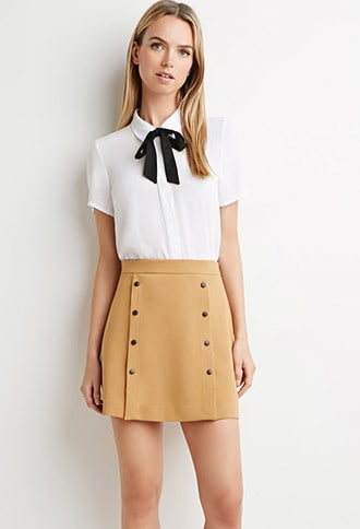 Short, tan button front skirt