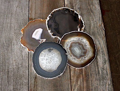 agate coasters on aged wood surface