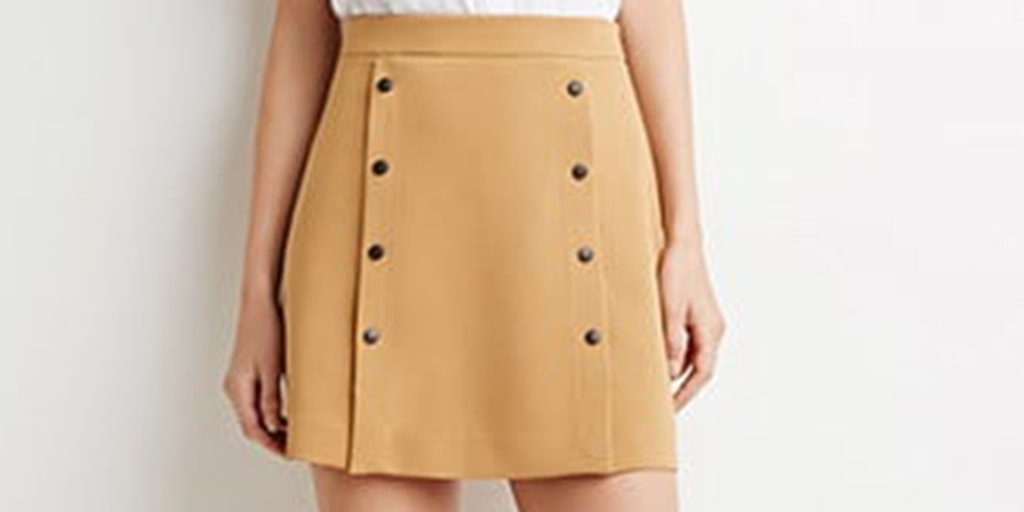 close up of tan, button front skirt