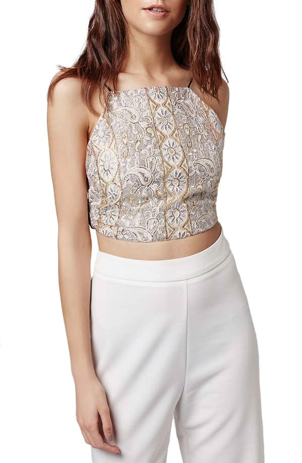 Woman wearing embellished crop top and pants