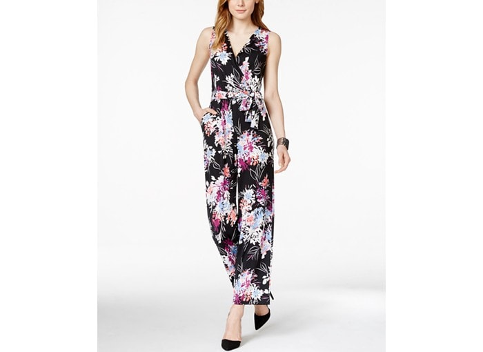petite model wearing floral jumpsuit