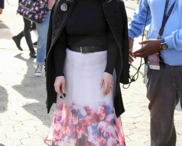 kelly osbourne style - wearing floral skirt and leather jacket
