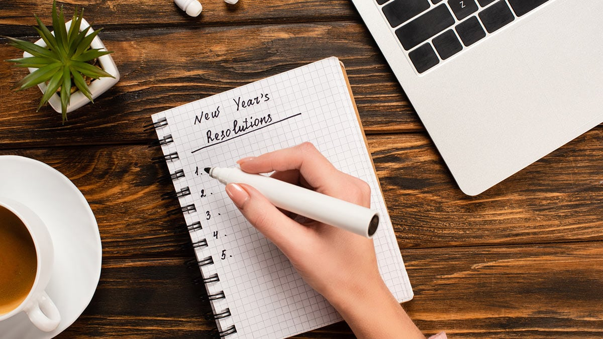 Woman writing new years resolutions