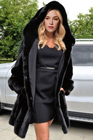 Woman wearing black dress and faux fur coat