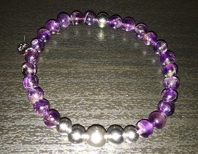 purple amethyst bracelet on black background