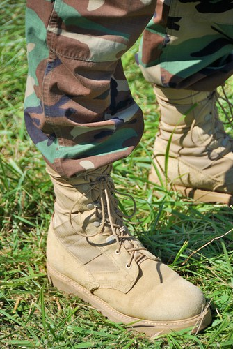 foot soldier in camouflage pants and boots