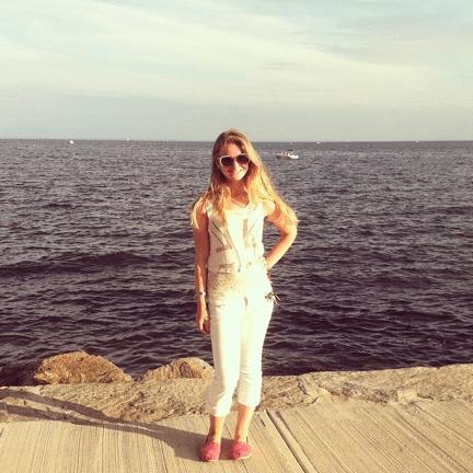 girl in front of ocean wearing capris