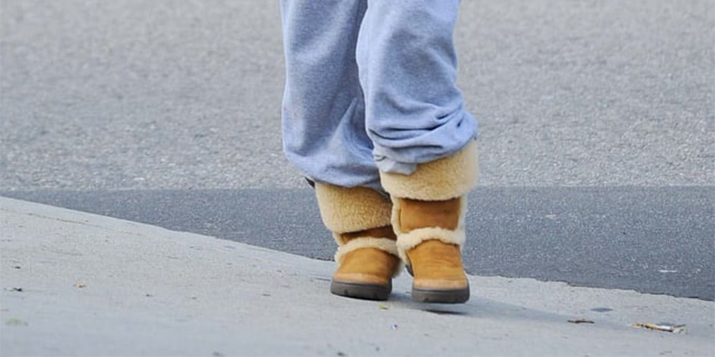 Baggy pants tucked into boots