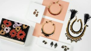 assortment of jewelry on white table