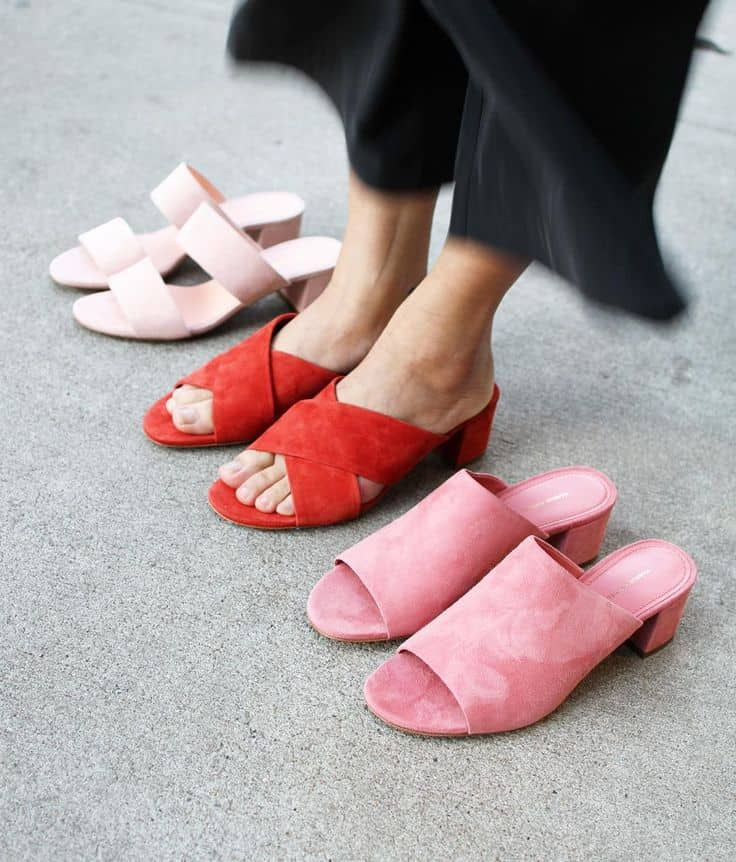 white, red and pink pairs of mules with woman's feet in the red pair