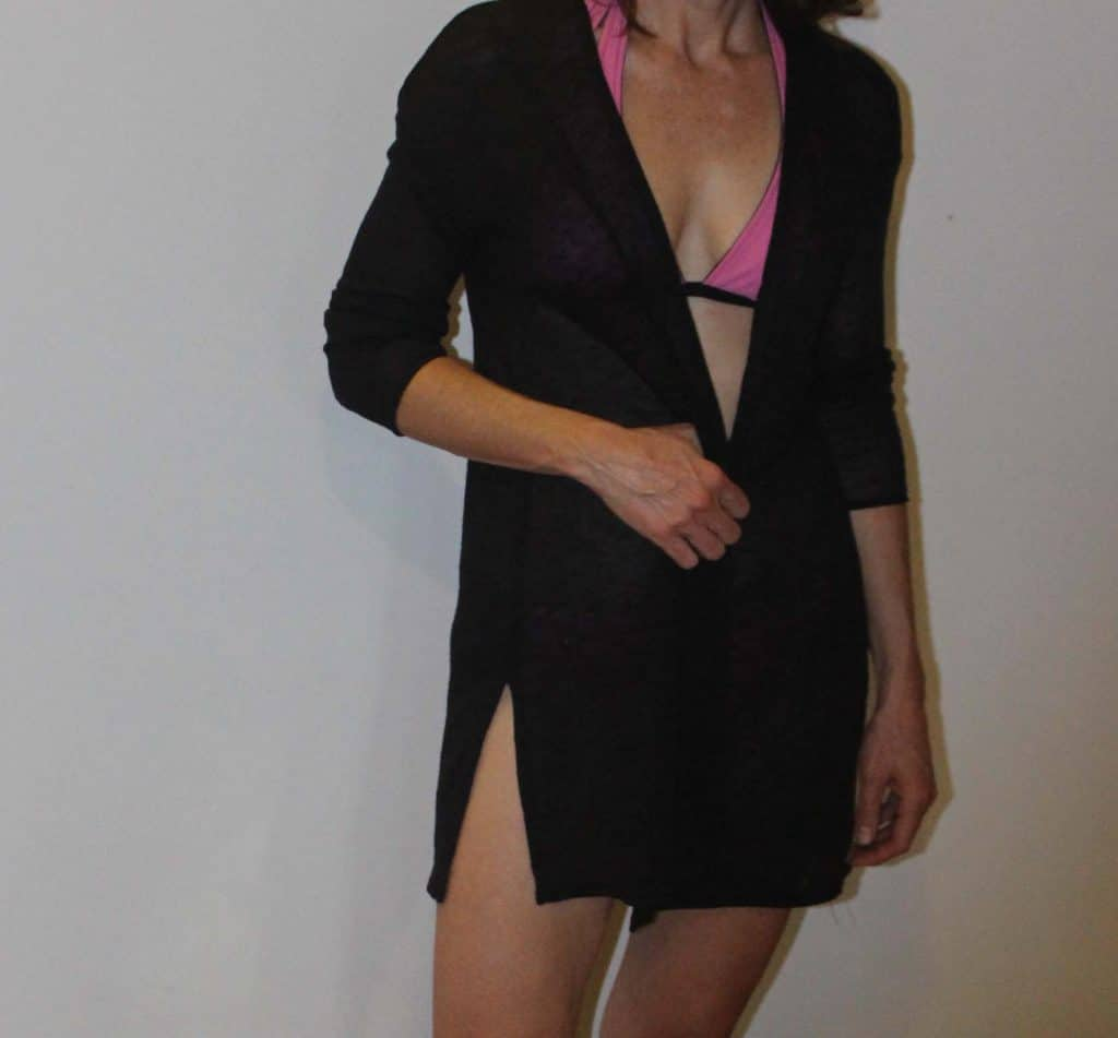 woman wearing cardigan over a bathing suit