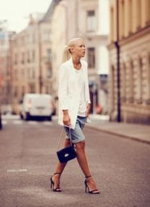 woman walking on a city street wearing knee length shorts