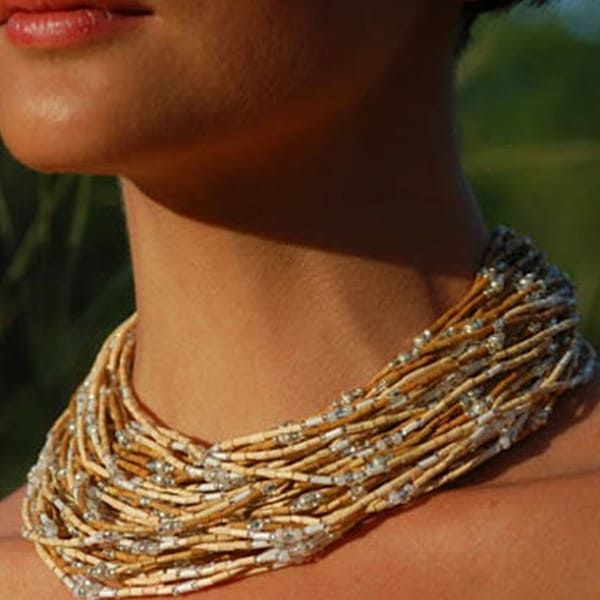 neck of woman wearing multiple strands of beads as a necklace