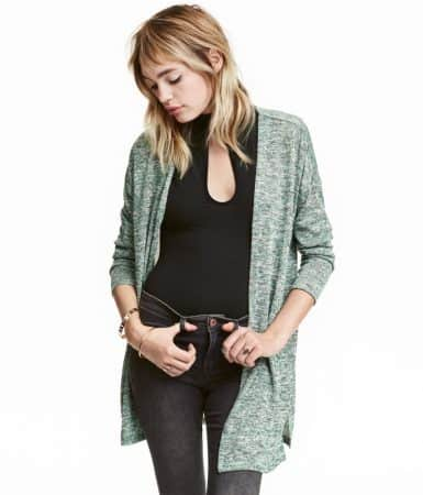 Woman wearing sheer cardigan over tank and jeans