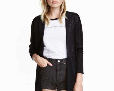 model wearing shorts and sheer cardigan