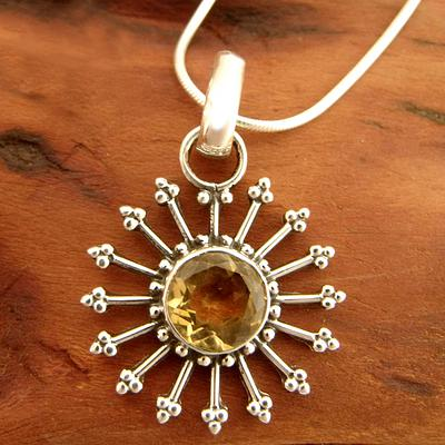 necklace pendant with a large brown stone and gold prongs