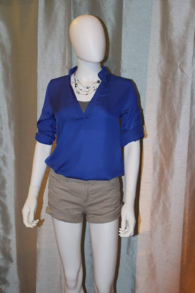 mannequin wearing blue blouse with shorts