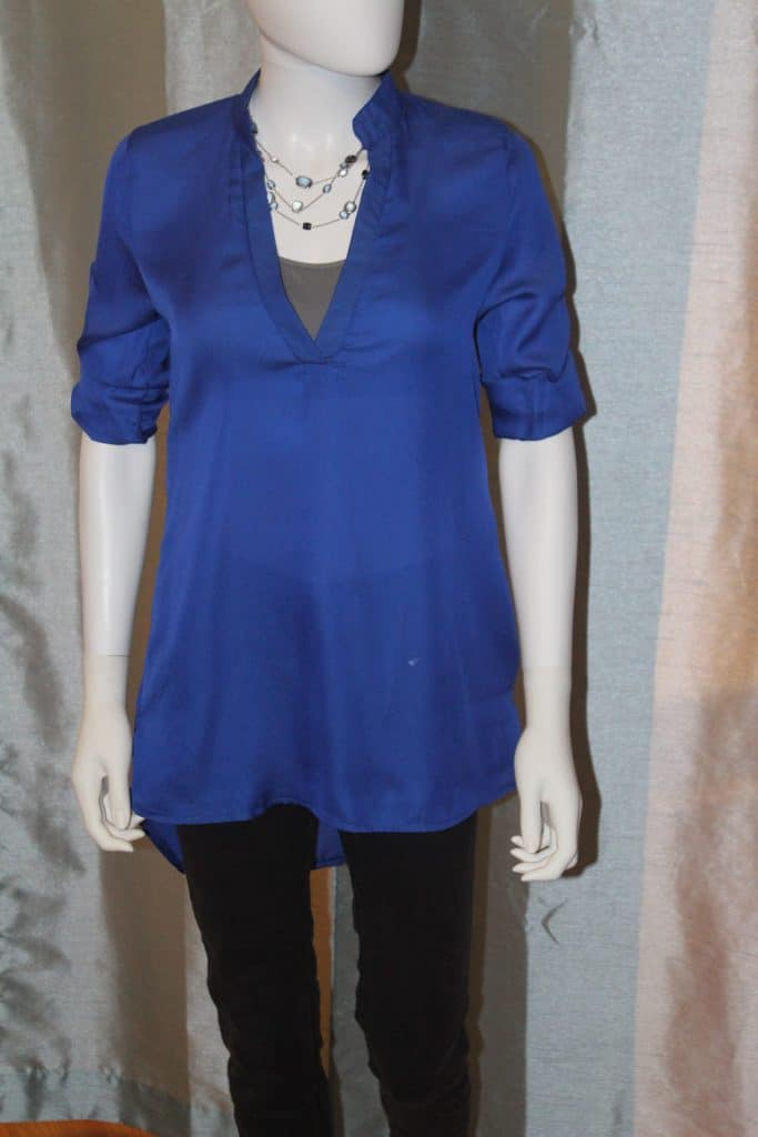 mannequin wearing blue stand collar blouse