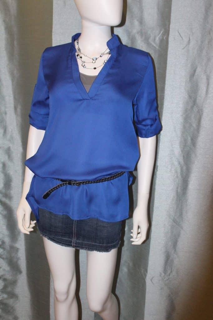 mannequin wearing blue blouse and denim mini skirt