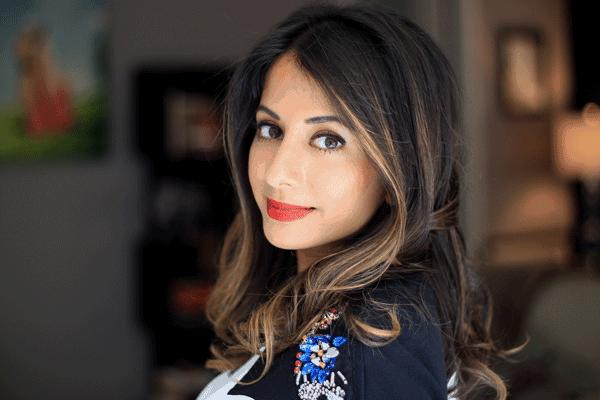 headshot of anisha mukherjee, founder of dress for the day