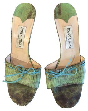 Pair of green snakeskin sandals