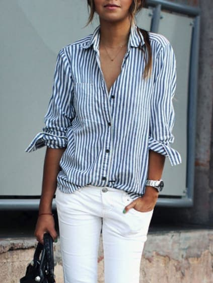 woman wearing white button down blouse with blue stripes