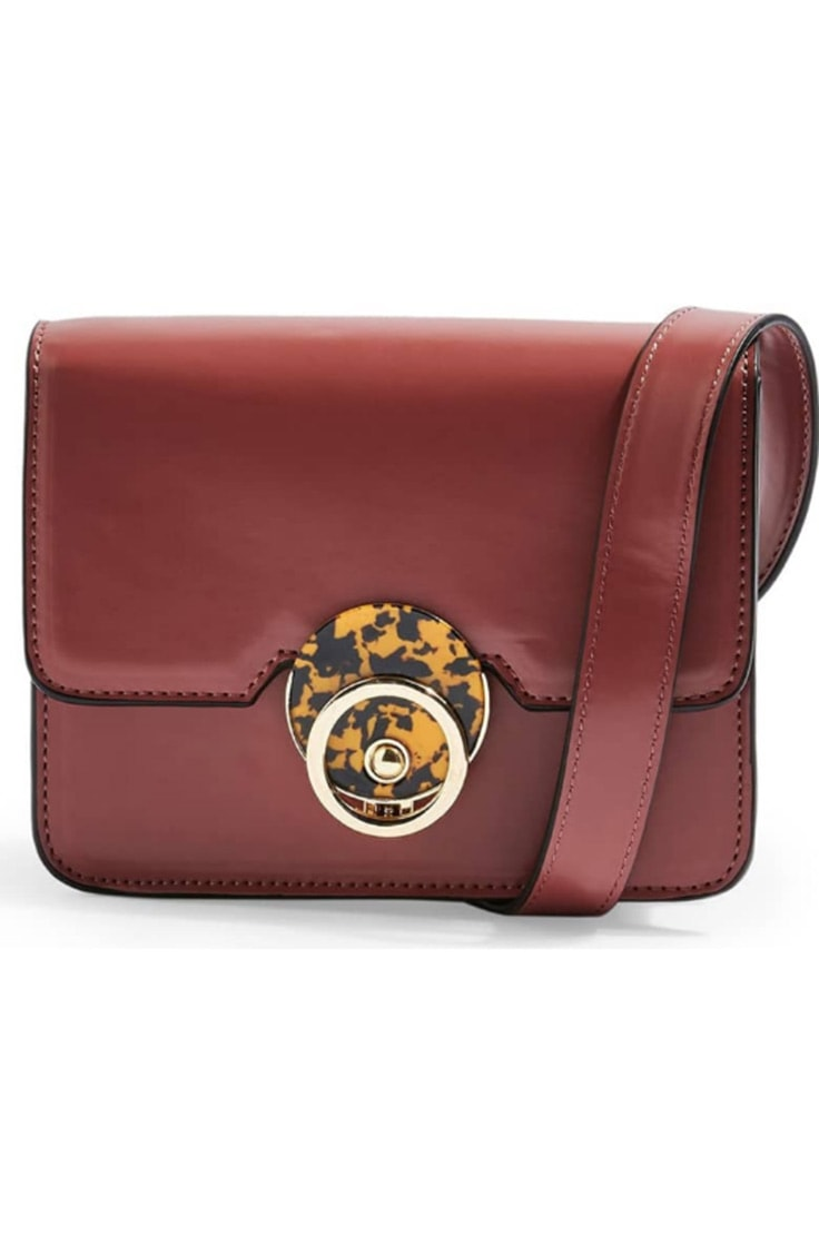 Rust belt bag with animal print clasp