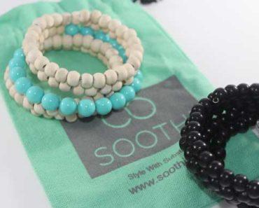 beaded bracelets on green background