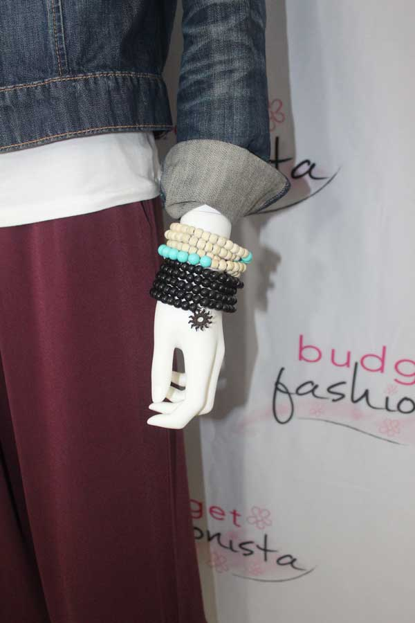 mannequin wearing beaded stacked bracelets